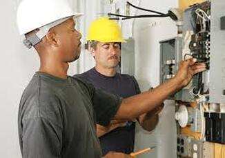 Electricians fixing circuit box